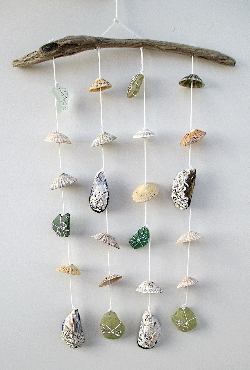 http://www.iconhomedesign.com/diy-wind-chimes-ideas-to-create-beautiful-decoration.html/diy-seashell-wind-chimes